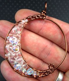 Handmade Crescent Moon Glass and Copper Wire Pendant. $30.00, via Etsy.