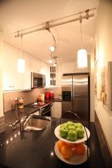Install track lighting in the kitchen for extra pizazz as well as task lighting