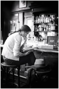 "Reading at bar in Amsterdam. Photograph by Edwin Loekemeijer. ""Street photographer. Wandering around. Always observing. Trying to catch special moments. Seeing, feeling and absorbing the world around me. A passion for photography."""