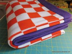 In my earlier post on high school graduation gifts you can sew, I forgot to include fleece blankets. I am making some in college colors as presents for a few high school grads. The technique I use …
