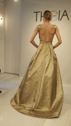 Gold wedding dress with ball gown skirt. And it has pockets! Bridesmaids dresses in three colors, cream, Tiffany blue or turquoise, and brown. I love the fabric. I want to close the back so they must be made.
