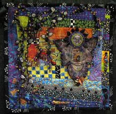"""""""Garden of Beadin' """" by Debbie Griffon, 10""""x10"""", began with an orphan block. The quilt has heavy beading, handmade fabric beads, foiled fabrics, angelina, and a paperclay face for the angel."""