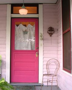 Wonder if I should/could paint my house pink too! Like the cottagey feel of the material/drap in the window too.