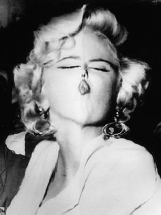 Marilyn Monroe as part of famous faces transformed by the lens of Weegee (Arthur Fellig).