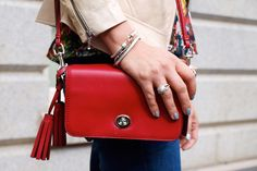 21 Dreamy Handbags Spotted On Real-Life D.C. Ladies #refinery29  http://www.refinery29.com/44360#slide-11  A cheerful red crossbody bag adds the perfect pop to Style'N blogger Naina's look.  Photographed by Kate Hoffman