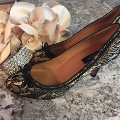 """PRICE⬇️!  LIKEAT Abbey Lace High Heels AMAZING DEAL - AN ORIGINAL RETAIL PRICE OF $178!   Step out in style with this classy pump featuring a lovely, delicate black lace overlay, finished with a tiny black bow. Rounded toe with padded leather footbed for added comfort.  Leather sole.  3.5"""" heel. Shoes"""