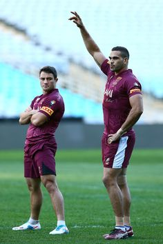 (L-R) Cooper Cronk and Greg Inglis look on during a Queensland Maroons state of origin training session at ANZ Stadium on June 4, 2013 in Sydney, Australia.