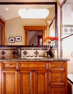 Beautiful finish and stain on these bathroom cabinets ♥ Click on this pin to see the rest of this amazing home!
