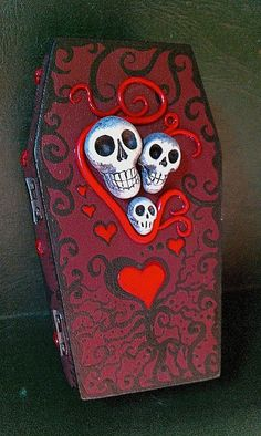 A one of a kind keepsake.  These elaborately-decorated, hand-painted 'Cackling Coffins' made such a huge hit at the 2011 Halloween Horror Hootenanny in Nashville (hosted by legendary TV horror host, Dr. Gangrene) that more had to be conjured up to appease the masses!  A sassy trio of skulls (each with my typical glow in the dark elements!) are the grinning centerpiece to this whimsical, unique Day of the Dead 'Cackling Coffin.'
