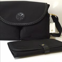 Tory BURCH Diaper Bag Authentic Tory BURCH diaper bag. Black nylon material with black leather trim details. Includes diaper changing pad. New with tags. Retails currently for $350. Make me an offer, or purchase for less on my merc. Tory Burch Bags Baby Bags