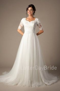 modest wedding dresses |  Mansfield | LatterDayBride & Prom | SLC | Utah | Worldwide Shipping | This darling modest wedding dress works for all seasons. This A-line gown features a lovely lace bodice and illusion half sleeves.  Gown available in White, Ivory or Pink/Ivory   *Gown pictured in Ivory