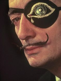 SALVADOR DALI....WITH HIS OWN CREATION OF A DIAMOND...EYEPATCH...MAKE BY .HENRYK KASTON WHO FABRICED ALL OF DALI'S WORK IN THE 1980's AND 1990's.....PHOTO BY PHILIPPE HALSMAN....PARTAGE OF MAJA BRGLEZ