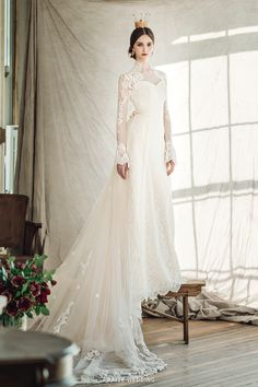 This timeless high-neck wedding dress from Clara Wedding featuring a detachable train is fit for a queen! » Praise Wedding Community