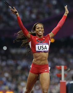 United States' Sanya Richards-Ross celebrates as she crosses the finish line to win the women's 4x400-meter relay final during the athletics in the Olympic Stadium at the 2012 Summer Olympics, London, Saturday, Aug. 11, 2012.
