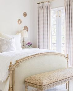 Alyssa Rosenheck - White and pink French bedroom features a French bed with headboard and footboard next to small gold sunburst mirrors over a nightstand situated across from a wall of windows dressed in pink drapes. Elegant Bedroom Design, Elegant Home Decor, Elegant Homes, French Country Bedrooms, French Country Decorating, Beautiful Bedrooms, Beautiful Interiors, Guest Bedrooms, Master Bedroom