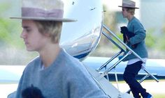Justin Bieber hugs new pup while boarding a private jet out of Miami