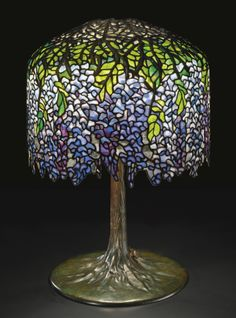 """** Tiffany Studios New York """"Wisteria"""" leaded glass and patinated bronze table…"""