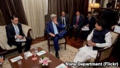 U.S. Secretary of State John Kerry, flanked by State Department Special Envoy and Coordinator for International Energy Affairs Amos Hochstein, sits with Indian Minister of Power Piyush Goyal on August 30, 2016, at the Le Meridien Hotel, in New Delhi, Indi