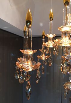 WINDFALL Chandeliers - The Balance in Golden Shadow & gold plated metal parts, golden tip mouth blown candles