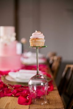 Wedding Cupcake Display Stand with Topper Cake   love love love this idea! you get the the cake topper and guests also get to choose a flavor! @ JuliesCafeBakery.com #cupcakes #recipe #cakes