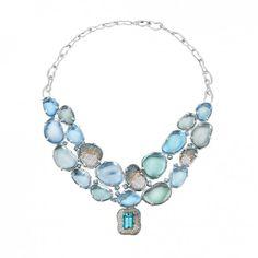 Madstone Design Poseidon necklace in 18k white gold with 155 tcw blue topaz, 72 tcw green amythest, 8.09 tcw Paraiba tourmaline, 5.21 tcw teal diamonds, 2.07 tcw white diamonds, 101 tcw champagne diamonds, and 1.29 tcw cognac diamonds.