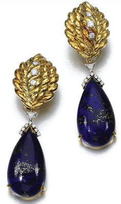 LAPIS LAZULI AND DIAMOND EAR CLIPS, DAVID WEBB The ear clips suspending a lapis lazuli drop surmounted by triangular and brilliant-cut diamonds,mounted in yellow gold and platinum, signed Webb.