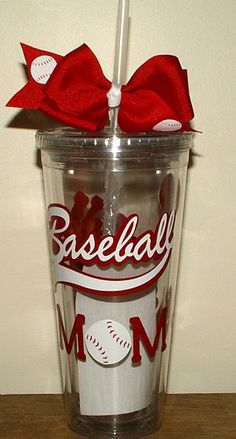 Baseball Mom 16 oz.Tumbler Cup. Acrylic Tumblers are double wall insulated that comes a bow with a screw on lid with and a matching straw that has a guard so it can't be pulled out. Tumblers can be used for cold drinks and hot drinks and fit any standard cup holder and are hand wash only.