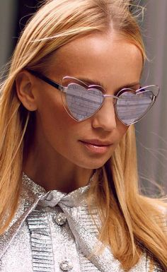 Saint Laurent's 'New Wave Loulou' sunglasses set to become this season's must-have style. This pair has mirrored lenses and open silver-tone frames. The almost cat-eye heart shape will flatter most faces, not to mention create the illusion of more defined cheekbones. Bring whimsical edge to every look with this statement pair. Sunglasses Saint Lauren Wave Loulou SL 197 #saintlauren https://lenshop.eu/manufacturers/9324-yves-saint-laurent/sunglasses