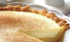 "Melktert, Africans for ""milk tart"", is a popular South African dessert consisting of a sweet pastry crust containing a creamy filling made from milk."