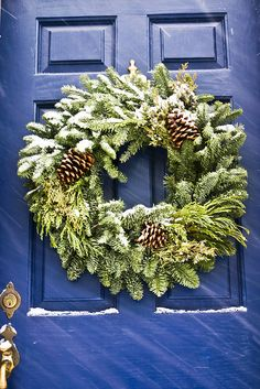 traditional wreath. now the question is do you get the nice fake one you can use over and over or do you get a different one each year so that it smells like christmas when you walk in the door? #wreath #door