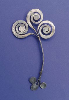 Brooch |  Alexander Calder.  Hammered Silver.  ca 1945 |  Sold by Christies NY on 15th Febuary 2000 for 26,450