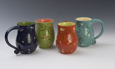 Flower Mugs by Lacey Goodrich. Hand thrown, hand glazed, functional mug. Approximately 5