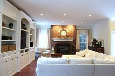 family room with tv in built-ins and fireplace to the side