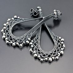Earrings | Sarah Thompson.  Fine silver wire, sterling silver beads.