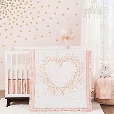 Your sweet girl will delight in a nursery decorated with the charming Lambs & Ivy Sweetheart Crib Bedding Collection. This lovely collection features pretty hearts in pink and white with glamorous touches of gold.