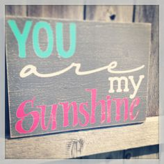My mom always sang this to me as as kid - will definitely be a tradition passed down. You Are My Sunshine Nursery Sign 12x16 aqua and hot pink