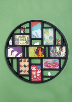 What a great frame! This would be fun in a family room or the kids' bedrooms!    Round Here Photo Frame, #ModCloth