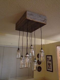 DIY Mason Jar Chandelier - Detailed instructions and parts list to boot!