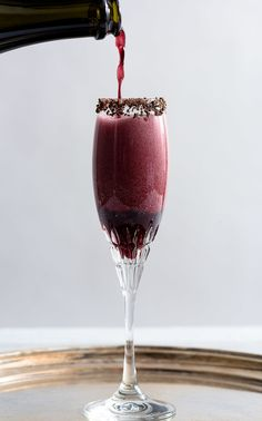 Sparkling Shiraz Cocktail with Dark Chocolate Coated Cacao Nibs from Nommagedon | The Best Champagne Cocktail Recipes
