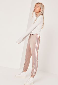 we're going all out when it comes to athleisure. rock the workout look to the streets and beyond in these satin joggers. in a neutral nude shade with contrast white stripe panel, sweet satin feel with high shine, cuffed ankles and an elasti. Cool Outfits, Summer Outfits, Casual Outfits, Fashion Outfits, Petite Outfits, Petite Dresses, Satin Joggers, Joggers Outfit, Sweatpants