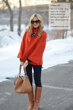 Riding boots, striped navy top, and tangerine bell-sleeved capelet with a camel colored bag