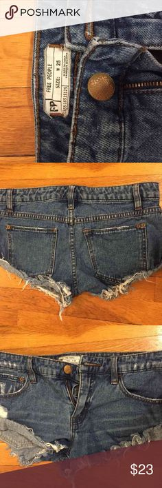 Free people jean shorts Low-rise free people jean shorts. Medium dark wash frayed cut. Worn a couple of times. They are in great condition. Free People Shorts Jean Shorts