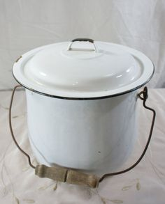 white enamel chamber pot with lid black trim wire and by gleaned