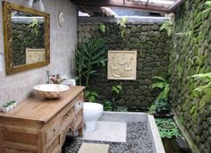 bathroom: Unique Stone Wall And Flower Ornaments In Extraordinary Tropical…