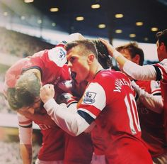 Arsenal players celebrate scoring