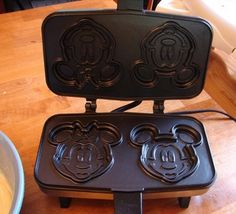 My mikey needs one of these =)) Mickey and Minnie Waffle Maker!!