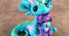 Just Pinned to #Cute: Dragon with kitty teddy by Dragons&Beasties http://ift.tt/2h0k2J6 http://ift.tt/2xtBeS7