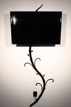 hide television wires art - Google Search