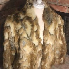 I just discovered this while shopping on Poshmark: Rachel Zoe Gorgeous Animal Print Faux Fur Coat. Check it out! Price: $129 Size: XS - see description