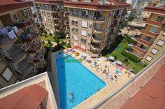 Трехкомнатные меблированные апартаменты в элитном комплексе в районе Оба рядом с морем - Оба Недвижимость - Алания Недвижимость - Анталия - Турция